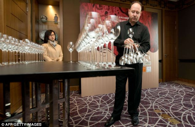 Phillip, pictured, managed 45 glasses in his first attempt and then an impressive 51 in his second smashing the previous record of 39