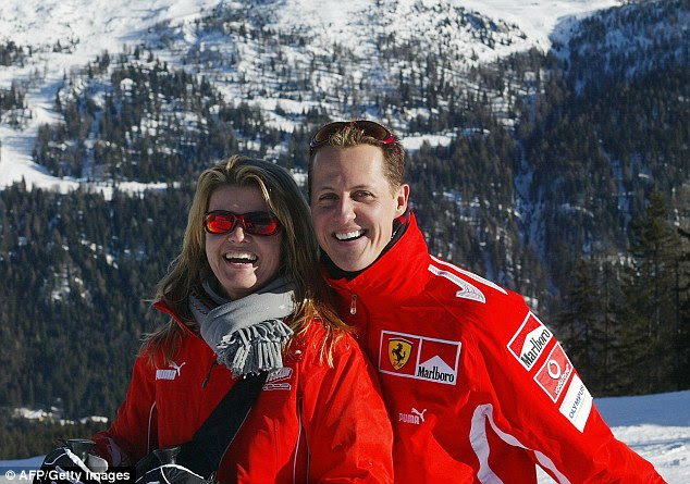 Schumacher, pictured with wife Corinna, was left in a coma after the horror ski crash in Meribel in the French Alps