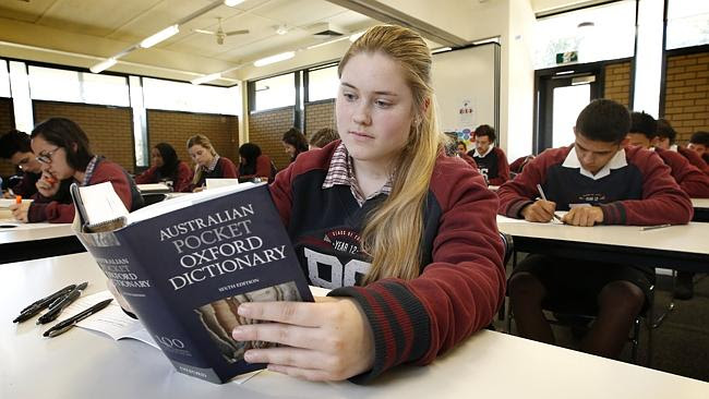 Kimberley Jurcan 18, uses a dictionary. Picture: David Caird.