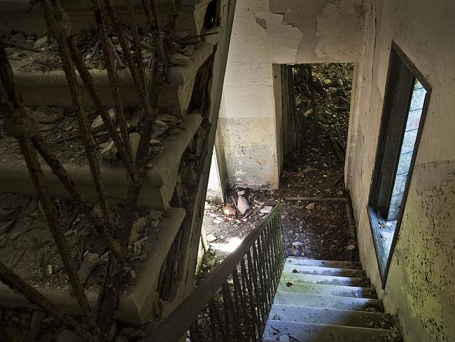Inside the station ... stairs in the kitchen area on Poveglia Island. Picture: Ella Pelle
