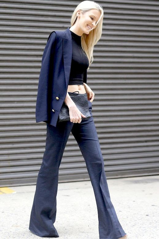 Le Fashion Blog Street Style Nyfw Feminine Look Kate Davidson Hudson Black Mock Neck Crop Top Navy Flared Pants Suit Via Popsugar
