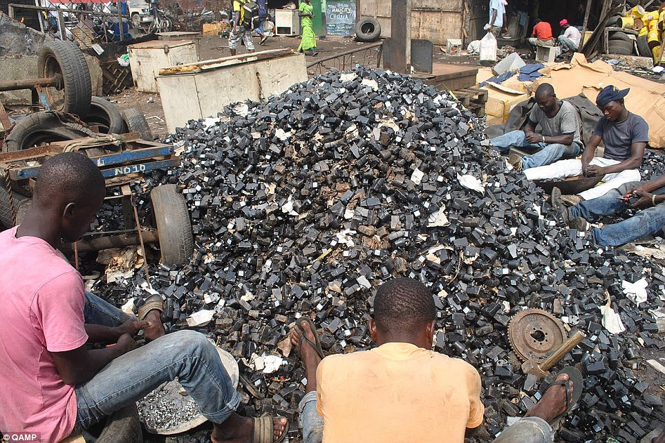 Desperate: Local Ghanaian's sift through mounds of old chargers in the hope that some of the still work and can be sold at market