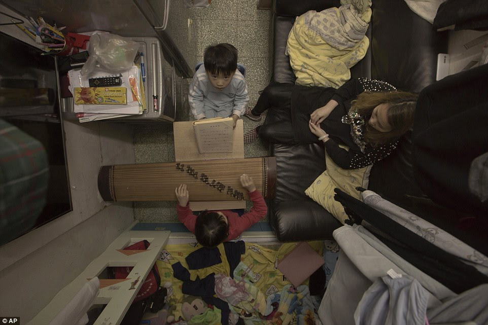 Single mother of two, Li Suet-wen, pays AUD$785 (USD$580, £447) for a 120-square-foot one-room 'shoebox' cubicle
