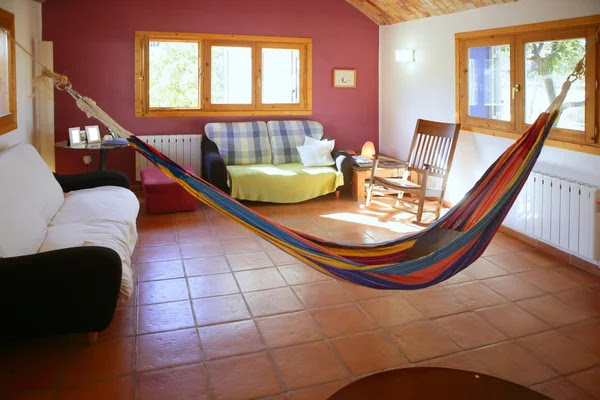 Living room in warm colors, mexican hammock — Stock Image © TONO ...