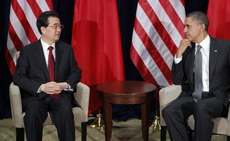 Tough talk: Chinese President Hu Jintao meets with President Obama in Honolulu, Hawaii where the subject of Iran's nuclear program caused tension