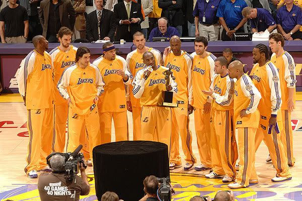 Kobe Bryant's teammates gather around him after he is awarded the 2008 NBA Most Valuable Player trophy at STAPLES Center in Los Angeles last night.  The Lakers then went on to defeat the Utah Jazz, 120-110, in Game 2 of the Western Conference Semifinals.