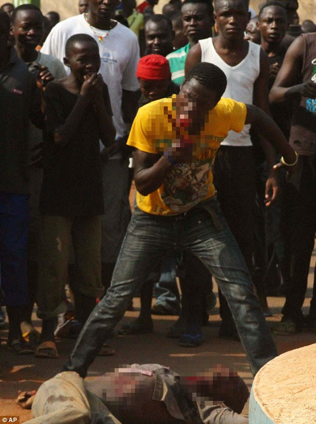 'Mad Dog' licks blood off a knife, as a crowd prepares to burn the body of a lynched Muslim man in Bangui