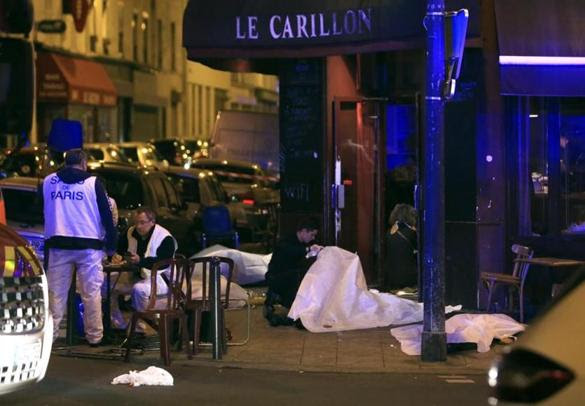 Victims laid on the pavement in a Paris restaurant.
