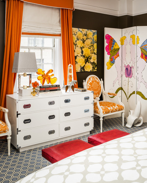 Bedroom - A pair of upholstered armchairs flanks a white bureau amid colorful curtains and accessories