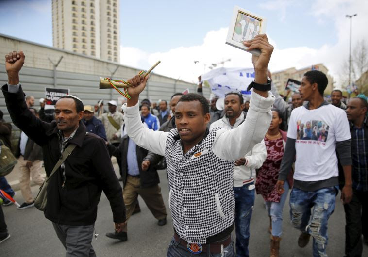 Israelis of Ethiopian descent take part in a protest in Jerusalem calling on gov't to bring the rema