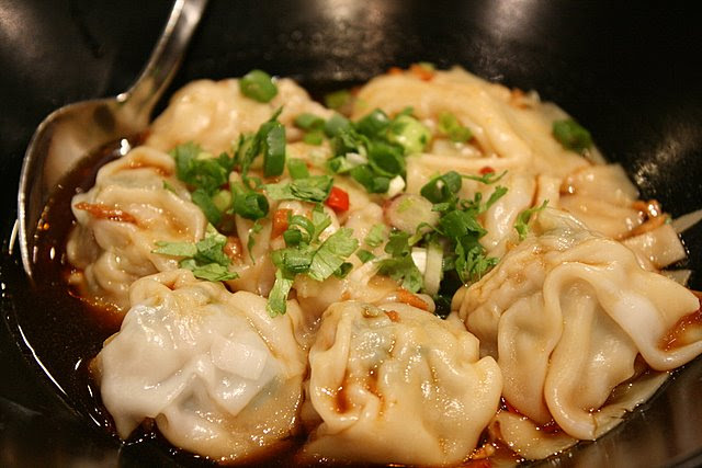 Dumplings in spicy chili sauce