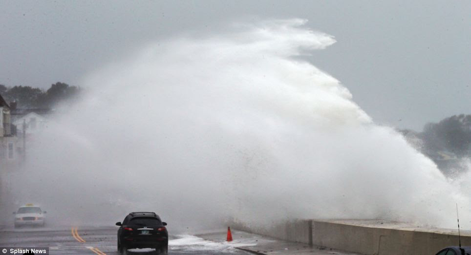 Astonishing scenes: Heavy waves smash over the seawall in Winthrop, Massachusetts this morning as what was then only classified as a hurricane moves closer to the region