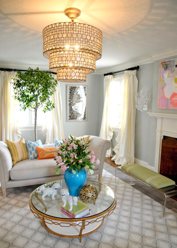 Grand Chandelier Lit Living With Floral Arrangement In Blue Urninterior Design Ideas