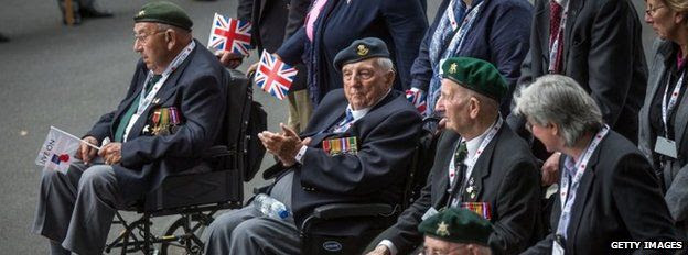 Veterans taking part in a parade down Whitehall
