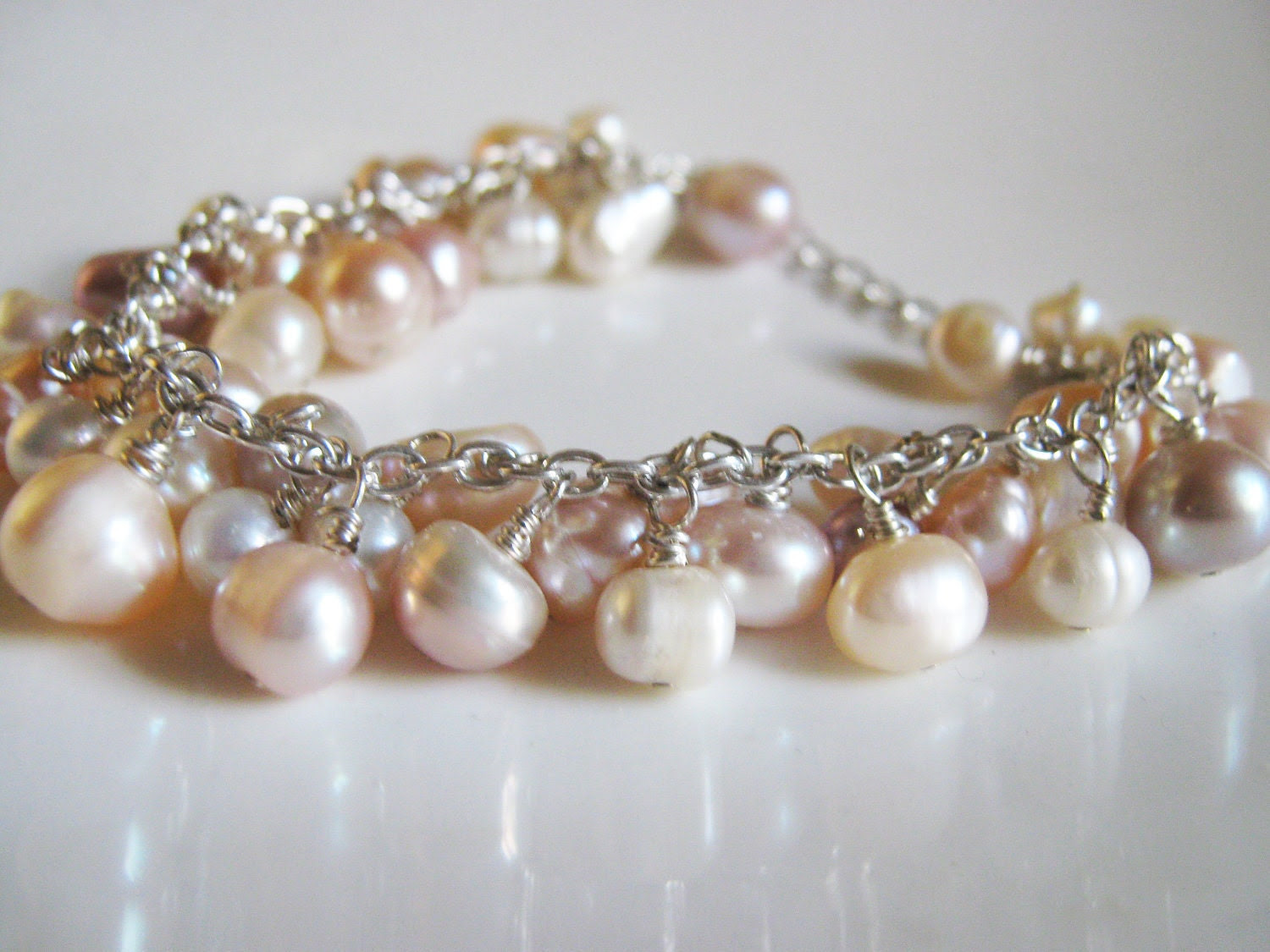 Freshwater Pearl Cluster Bracelet in Peach, white, cream, and mauve
