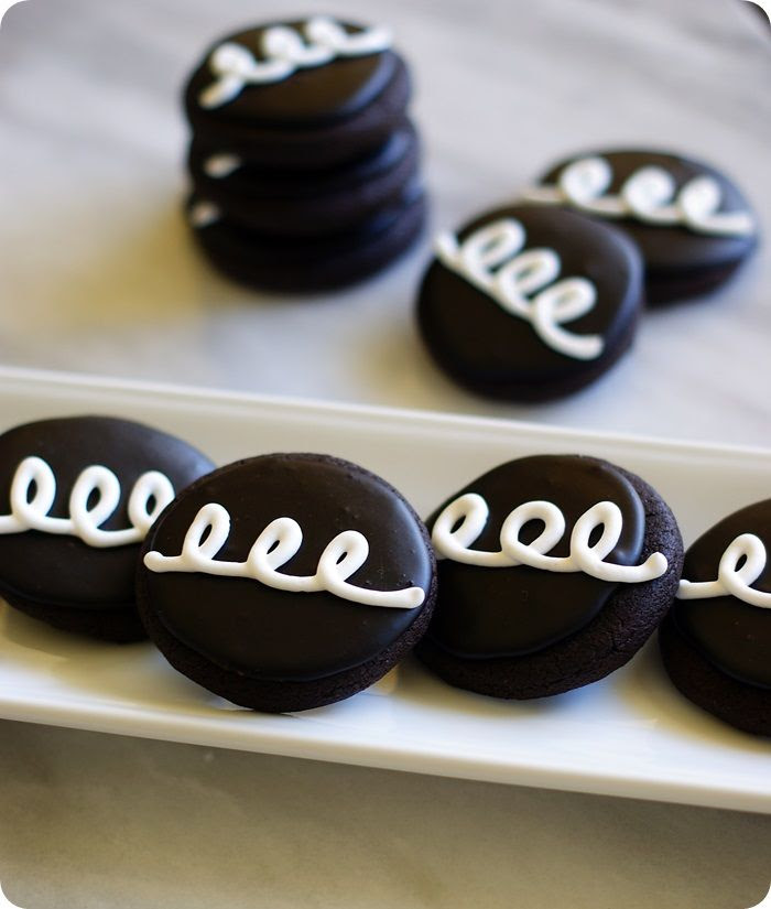 Hostess Cupcake Cookies!!!  (Chocolate cut-out cookies + recipe for dark chocolate glaze)from @bakeat350