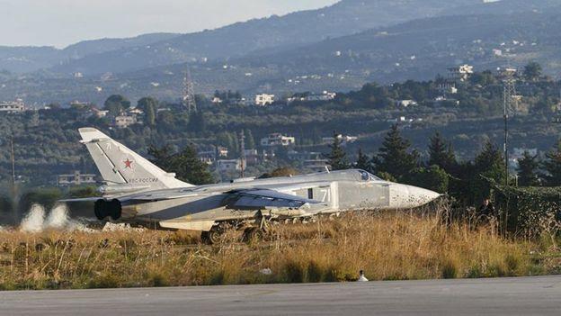 A Sukhoi Su-24 fighter jet taxis on the tarmac at the Humaymim air base near Latakia, Syria (11 November 2015)