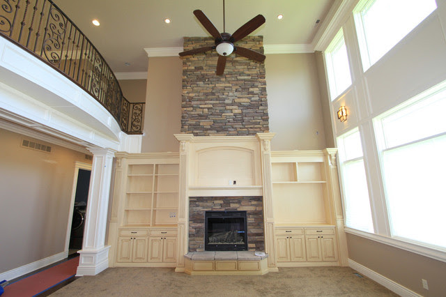 Karly rauner inspiration for a timeless open concept light wood floor living room remodel in other with a stone fireplace, beige. Fireplace off white with stone - Traditional - Living Room ...