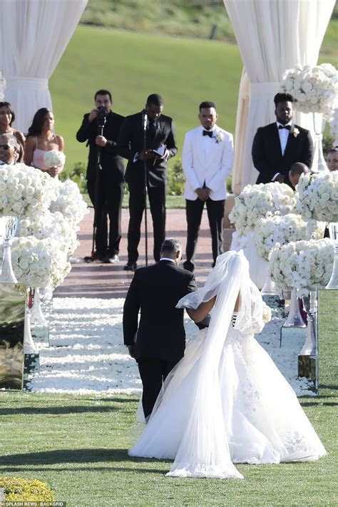Kim Kardashian and Kanye West show up LATE to Chance The