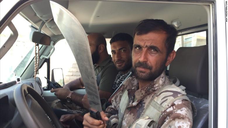 A man shows a machete to CNN's Ben Wedeman.