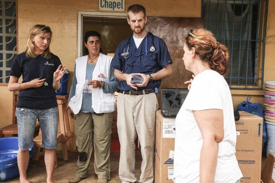 Dr. Kent Brantly (2nd R) speaks with colleagues at the case management center on the campus of ELWA Hospital in Monrovia, Liberia in this undated handout photograph courtesy of Samaritan's Purse. REUTERS-Samaritan's Purse-Handout via Reuters