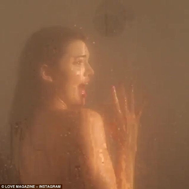 Kicking off Christmas with a scream! The video then cut to Kendall naked in a shower - inspired by the iconic scene from old-school horror Psycho