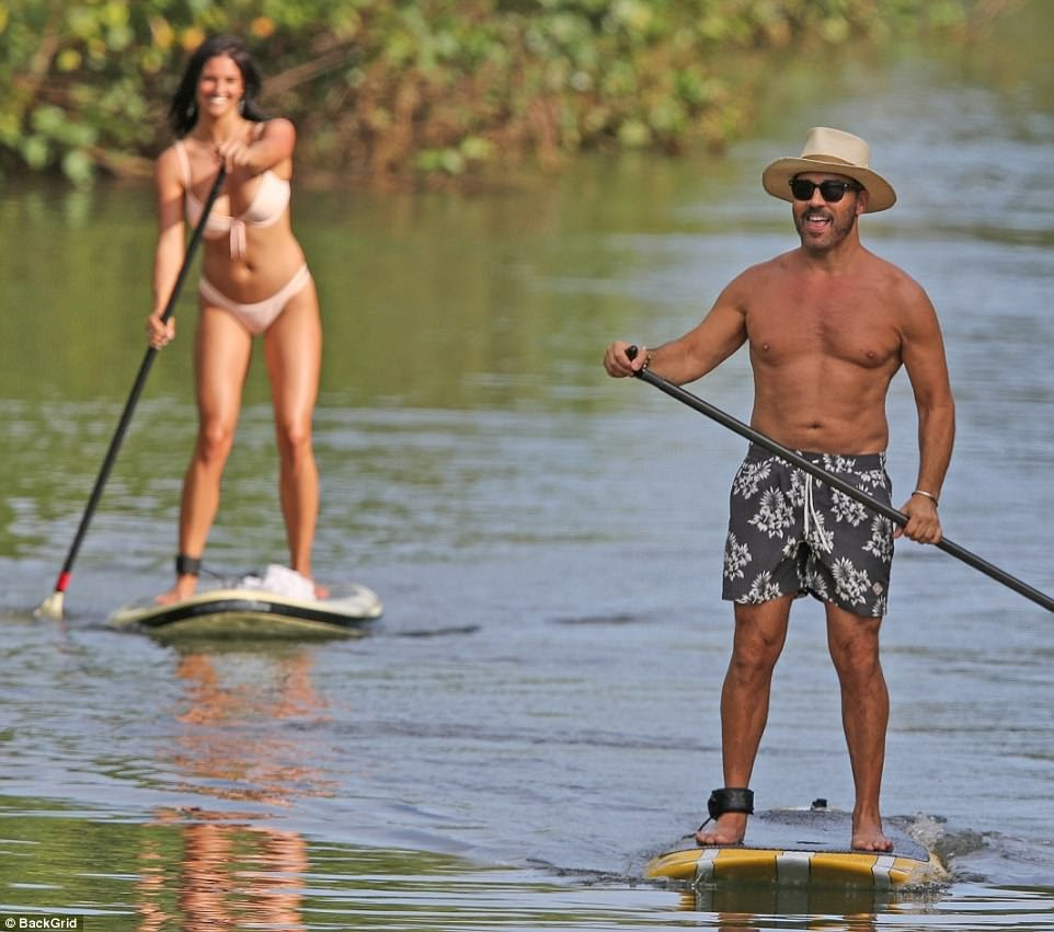 Life's a breeze: Jeremy Piven looked to be having a ball as he paddle boarded with his girlfriend in Maui, Hawaii on Saturday