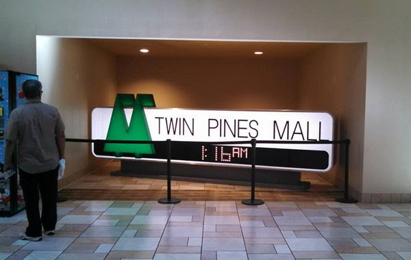 The Twin Pines Mall sign from BACK TO THE FUTURE is now on display inside Puente Hills Mall in the City of Industry.