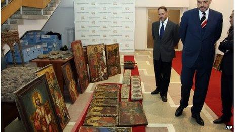 Albanian Prime Minister Edi Rama inspects stolen art in Tirana, 9 October 2013