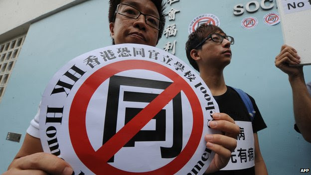 "Gay activists in Hong Kong protest against ""gay conversion"" therapy on 17 June, 2011"