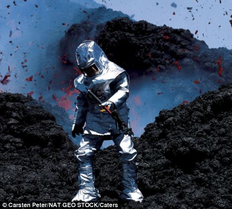A volcanologist testing a thermal suit near molten lava