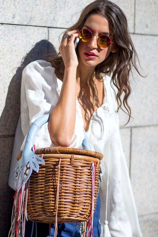 Le Fashion Blog Street Style Modern Boho Look Wavy Hair Round Mirrored Sunglasses White Top Fringed Basket Bag Via Harpers Bazaar