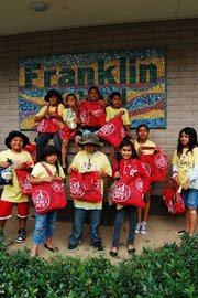 Kids Go Green with their reusable Trader Joe grocery bags.