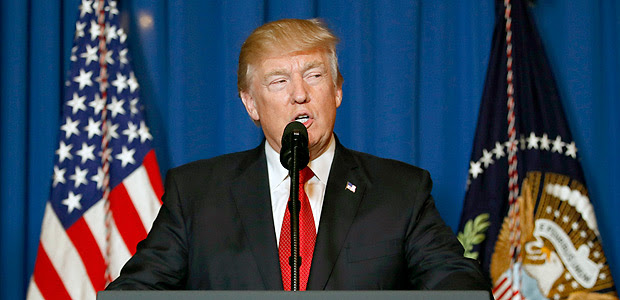 President Donald Trump speaks at Mar-a-Lago in Palm Beach, Fla., Thursday, April 6, 2017, after the U.S. fired a barrage of cruise missiles into Syria Thursday night in retaliation for this week's gruesome chemical weapons attack against civilians. (AP Photo/Alex Brandon) ORG XMIT: FLAB220