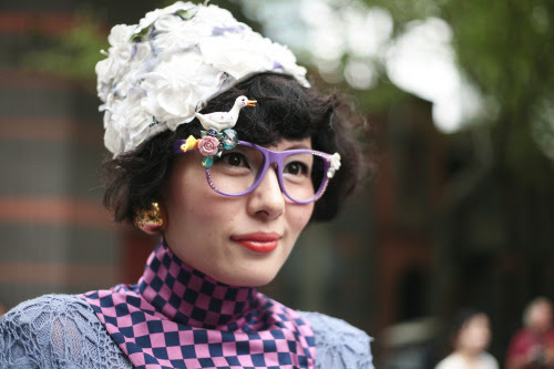 Kitsch embellishment updates these lensless glasses at Shanghai Fashion Week.