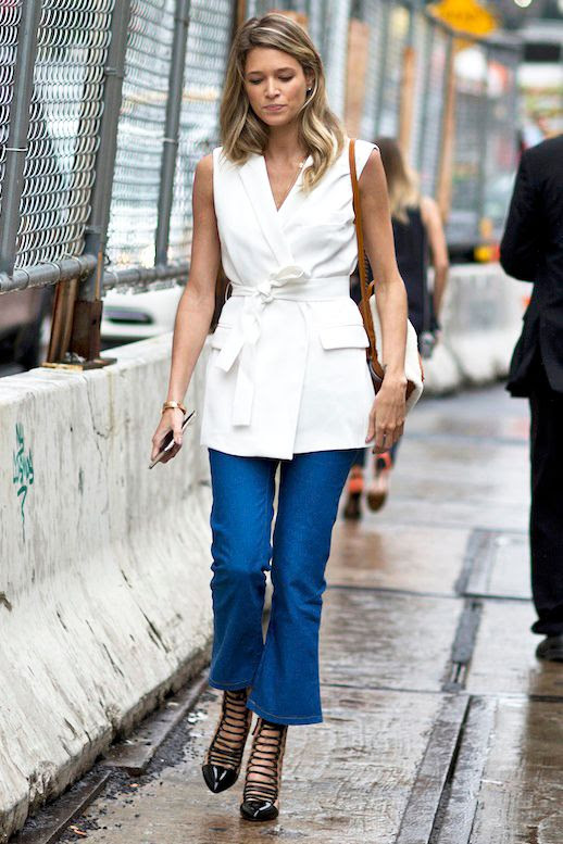 Le Fashion Blog Street Style Nyfw White Belted Sleeveless Blazer Cropped Flare Jeans Strappy Black Pumps Via Stylecaster