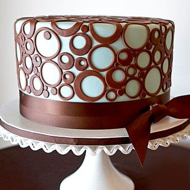 Cake decoration - For you fondant enthusiast, circles galores.  fondant covered with nothing but different cookie cutter circles.  Very modern.  love it.