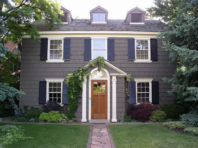 colonial with dormers in attic.  like the colors too.