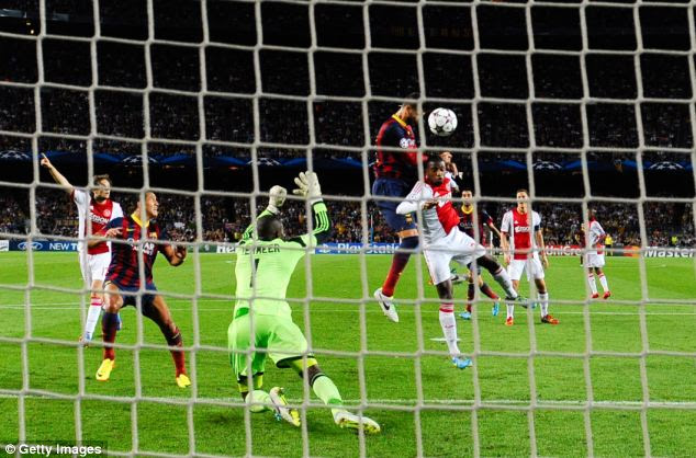 Heads up: Pique rises highest to score Barcelona's third goal