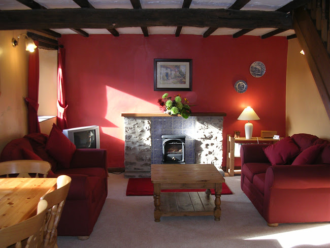 holiday cottage is just a few yards from the pretty village green of