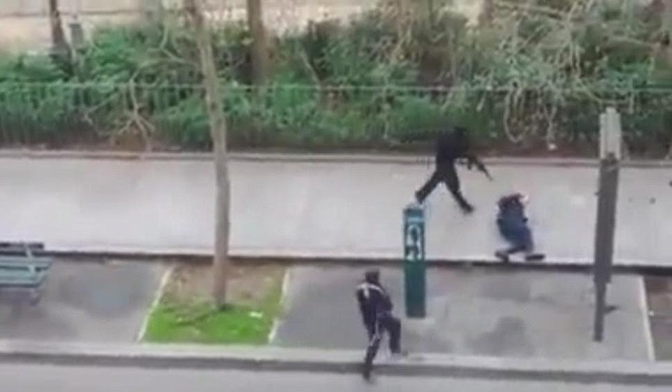 Brutal execution: A police officer pleads for mercy on the pavement in Paris before being shot in the head by masked gunmen during an attack on the headquarters of the French satirical publication Charlie Hebdo, a notoriously anti-Islamic publication