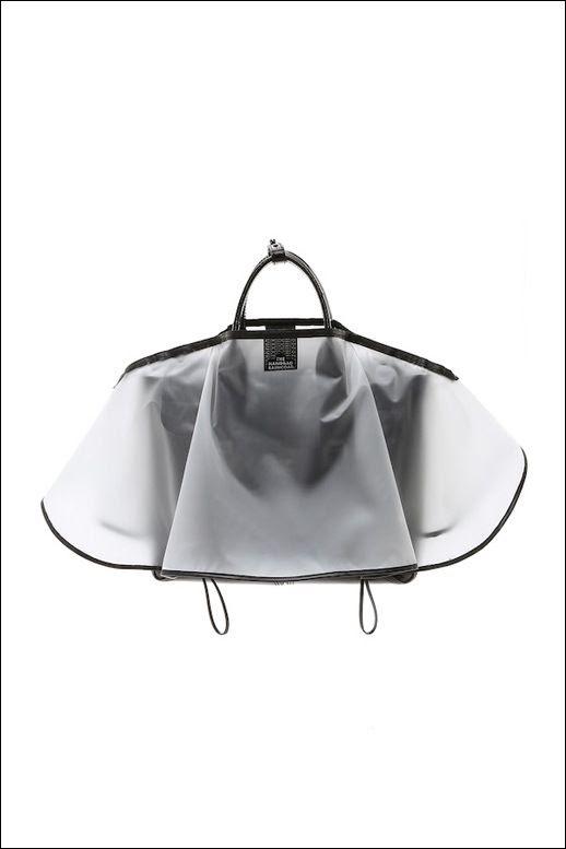 Le Fashion Blog The Raincoat Handbag Bag Protector Cover Rain Snow Style  photo Le-Fashion-Blog-The-Raincoat-Handbag-Bag-Protector-Cover-Rain-Snow-Style.jpg