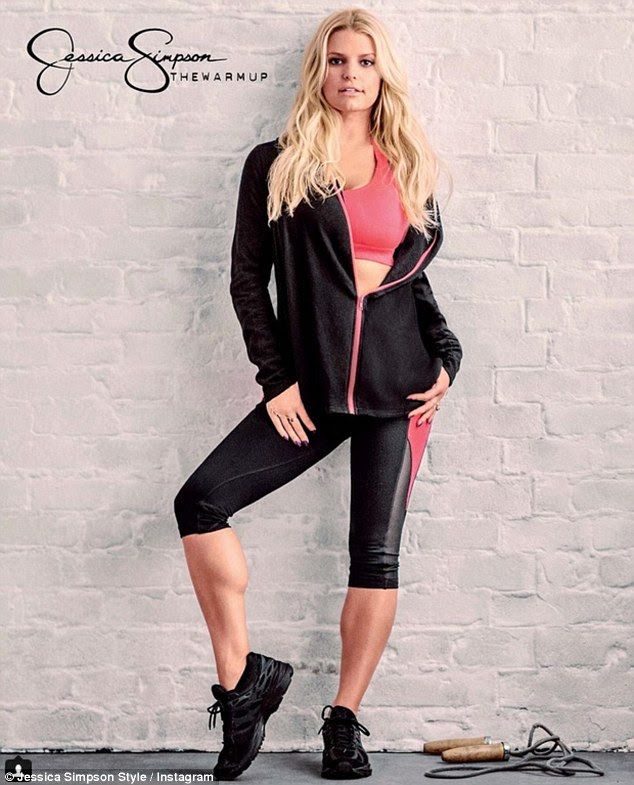 Jump for joy: Simpson donned a pair of black leggings, a coral pink sports bra, and a coordinating zip-up sweater as she posed beside a jump rope that sat on the floor