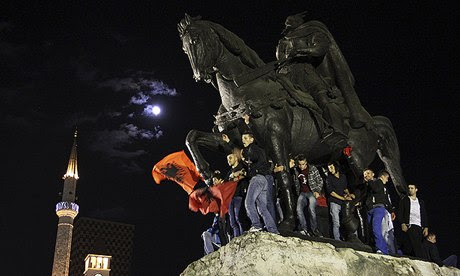 Albanians celebrate on a monument to national hero Skanderbeg after Edi Rama rejected the US request