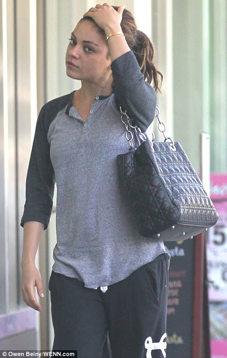 Daring to bare: Mila Kunis displayed a make-up free face as she left the gym in West Hollywood