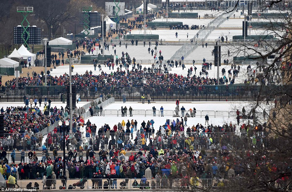 This view taken January 20, 2017 shows people gathering on the mall to witness President-elect Donald Trump take the oath of office as the 45th president of the United States