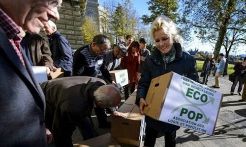 Swiss ambientalists of Ecopop collecting signatures for an anti-immigration referendum in Switzerland