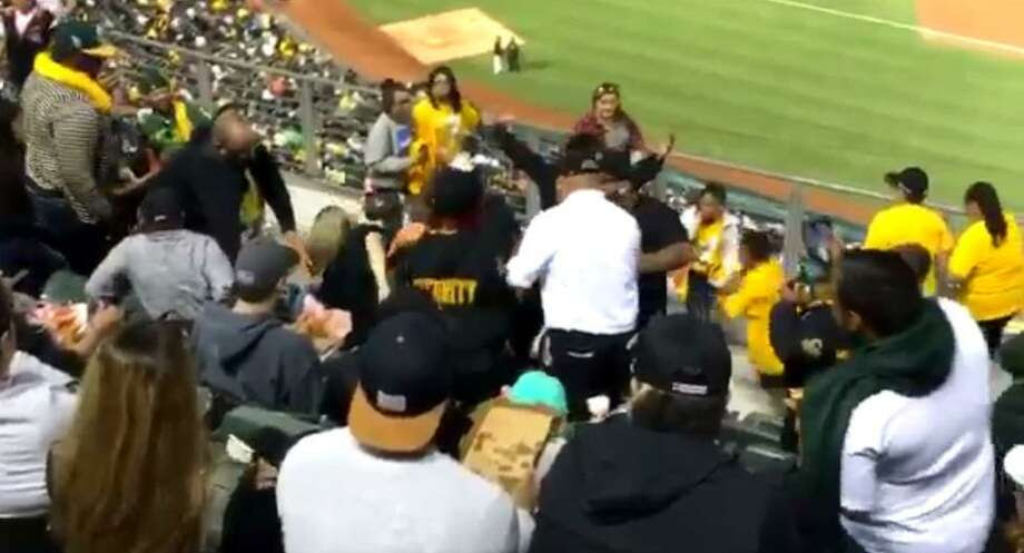 A security guard apparently attacked a woman at an Oakland Athletics game Monday. Photo: Screenshot From Video By Shane Siegrist