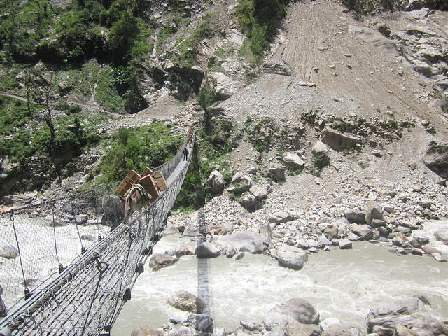 donkeys crossing a bridge between Chamje and Tal