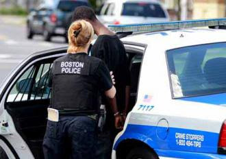 Boston police arrest a young Black man